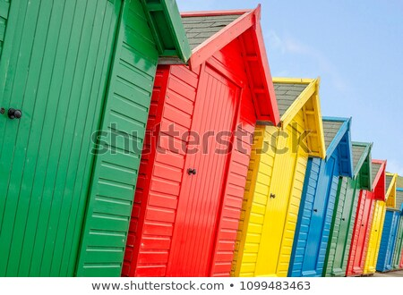 Row of colorful wooden beach huts in Whitby stock photo © photohome