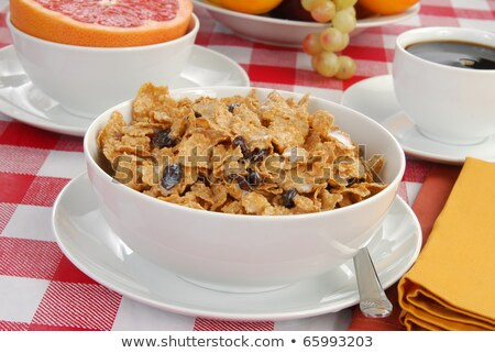 Healthy breakfast of bran flakes, pink grapefruit and grapes Stock photo © raphotos