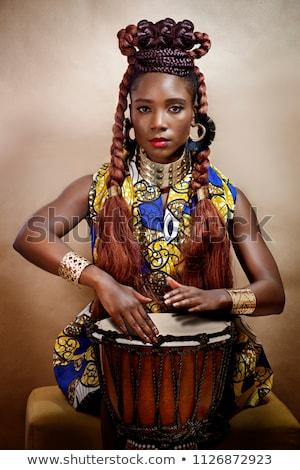 Attrattivo giovani african donna giocare tradizionale Foto d'archivio © HASLOO