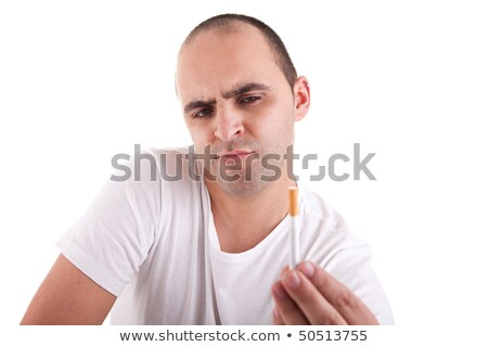 man torn between smoking and not smoking stock photo © alexandrenunes