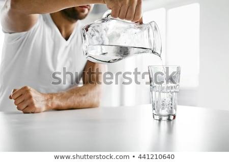 Foto stock: Moço · água · potável · água · esportes · azul