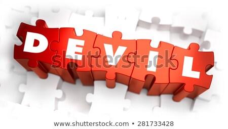 Duivel tekst Rood witte selectieve aandacht puzzel Stockfoto © tashatuvango