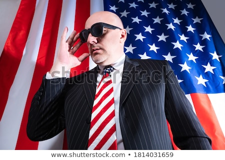 Man in black glasses and tie with microphone stock photo © boroda