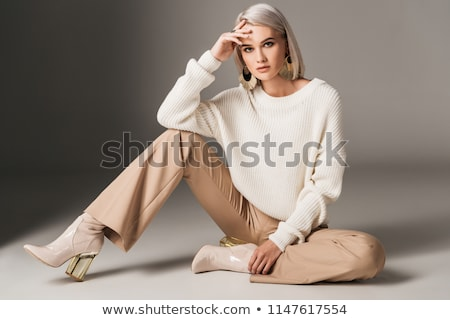 studio shot of a young beautiful blond fashionable woman stock photo © konradbak