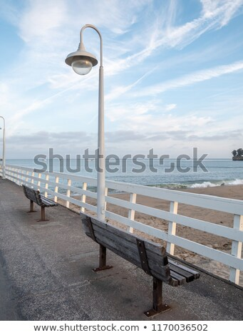 Two benches overlook the ocean on California pier Stock photo © emattil
