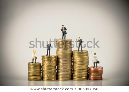 Business people on pile of coins. Business competition concept Stock photo © Kirill_M