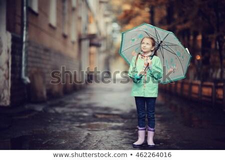 little girl with umbrella on street autumn season Stock photo © goce
