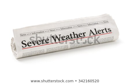 Rolled newspaper with the headline Severe Weather Alerts Stock photo © Zerbor