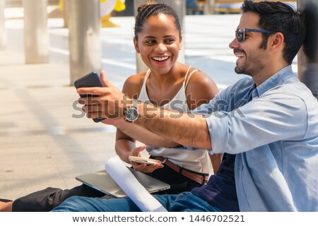 бизнесмен · мобильного · телефона · команда · вид · сбоку · служба · телефон - Сток-фото © deandrobot