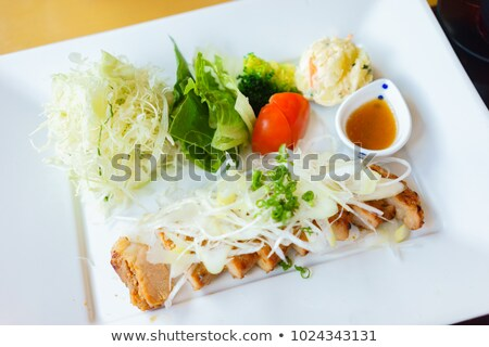 Stock photo: Pork skewer and spring salad mix