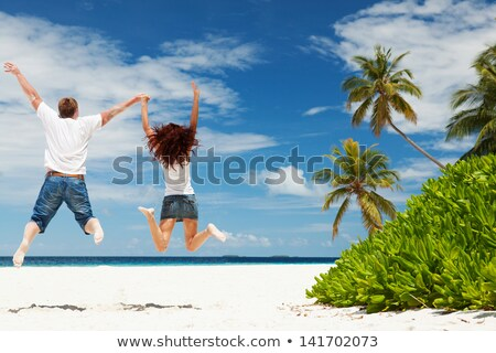Summer girl vacation. Happy woman running and jumping on exotic  Stock photo © Victoria_Andreas