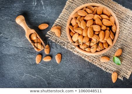 almonds on a wooden background Stock photo © Valeriy