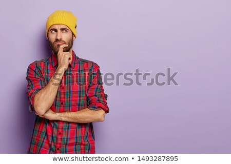 Casual man in plaid shirt thinking and contemplating Stock photo © stevanovicigor