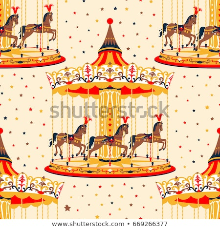 A merry-go-round with brown horses Stock photo © bluering