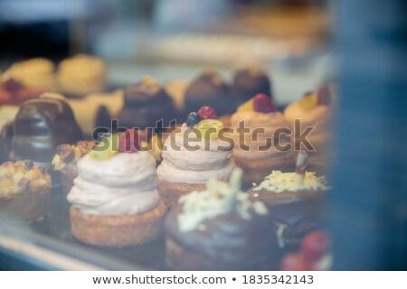 Pastries on glass window Stock photo © georgemuresan