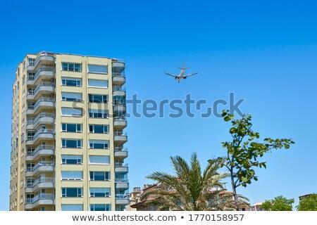 Repülőgép magas épületek illusztráció üzlet épület Stock fotó © bluering