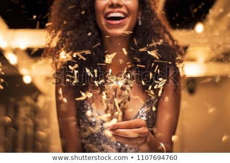 Stok fotoğraf: Attractive Young Woman Celebrating With A Sparkler