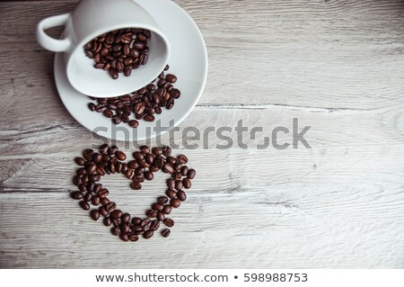 cup of coffee wirh roasted beans stock photo © wdnetstudio