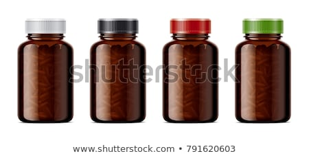 Brown pills and a bottle of medicine stock photo © ironstealth