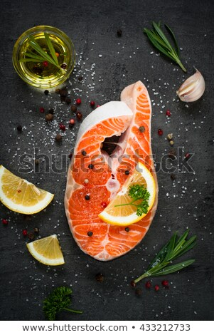Salmon fish steak on black background copy space top view Stock photo © yelenayemchuk