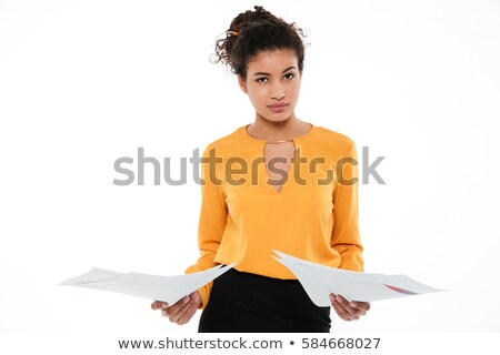 Confused young curly african lady standing with documents Stock photo © deandrobot