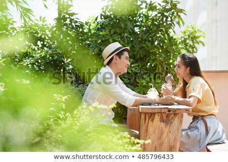 glimlachend · asian · jonge · liefhebbend · paar · vergadering - stockfoto © deandrobot