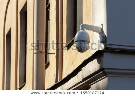 Foto stock: Cctv Camera On Orange Building Facade