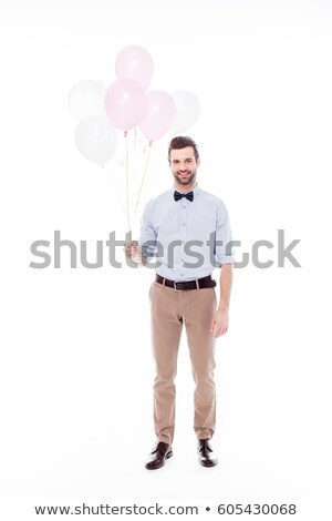 Stock photo: Vertical image of Smiling man holding air balloons