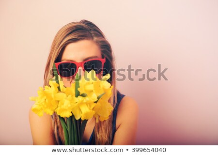 portrait of the girl with narcissuses stock photo © dashapetrenko