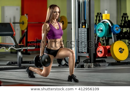 beautiful girl bodybuilder ,  execute exercise with  dumbbells Stock photo © chesterf