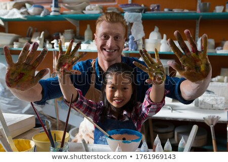 male potter and girl showing their painted hands stock photo © wavebreak_media