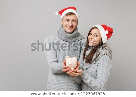 couple shopping holding up pullover Stock photo © IS2