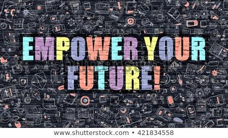 multicolor empower your future on dark brickwall doodle style stock photo © tashatuvango