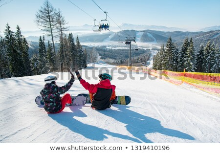 woman and man with ski and snowboard Stock photo © IS2