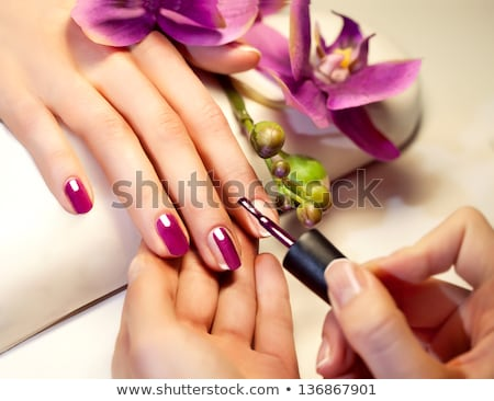 Nail polish manicure. Woman finger with varnish on nails Stock photo © Terriana