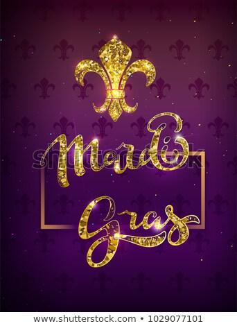 golden lily silhouette symbol festival mardi gras greeting card gold text decoration stock photo © orensila