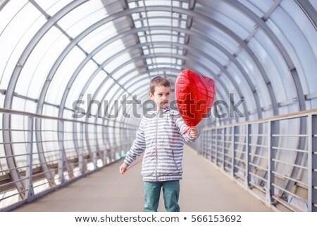 Mosolyog fiú hélium léggömbök jókedv boldogság Stock fotó © IS2