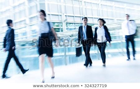 Stock photo: businessman walking in skywalk