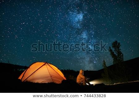 Leitoso maneira amarelo tenda montanhas Foto stock © denbelitsky