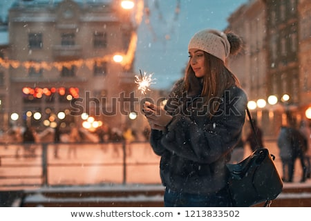 Lány tart citromsárga girland fények fiatal lány Stock fotó © artjazz