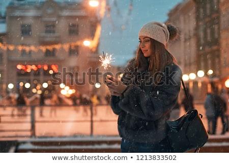 Girl holding yellow garland lights Stock photo © artjazz