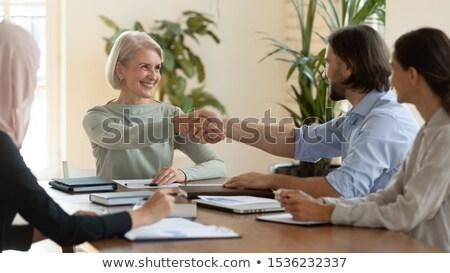 mayor · hombre · joven · apretón · de · manos · oficina · negocios - foto stock © is2