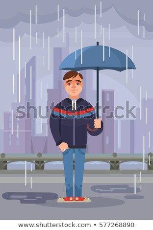 Young boy under a parasol Stock photo © IS2