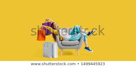 Nő ül bevásárlótáskák nappali kanapé vásár Stock fotó © IS2