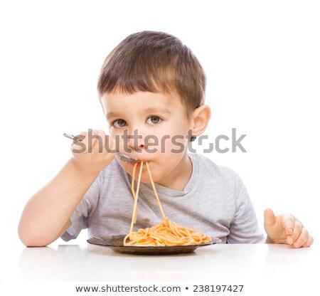 Boy eating spaghetti Stock photo © IS2