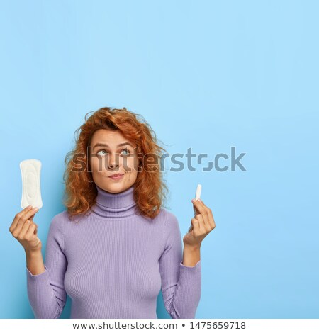 one menstrual tampon isolated on blue stock photo © lightfieldstudios
