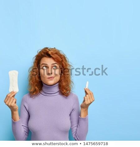 one menstrual tampon isolated on blue Stock photo © LightFieldStudios