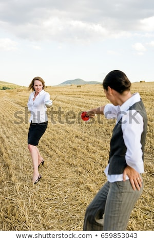Businesspeople fencing in a wheat field. Stock photo © IS2