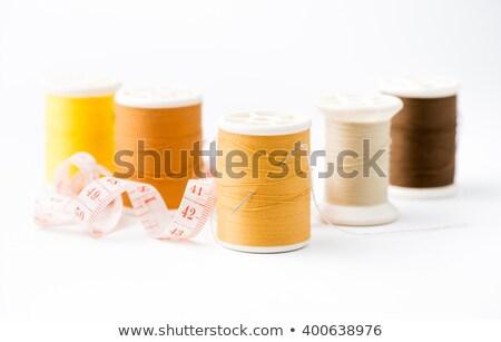 Naald oranje draad vingerhoed witte achtergrond Stockfoto © OleksandrO