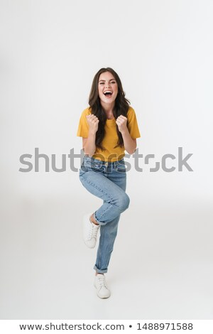 Photo of excited woman 20s in casual wear smiling and rejoicing  Stock photo © deandrobot